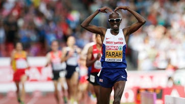 Britain's Mo Farah crosses the finish line to win the 5000 final during the European Athletics Championships in Zurich, Switzerland, Sunday, Aug. 17, 2014.