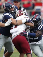 New Mexico State running back Xavier Hall (22) is tackled