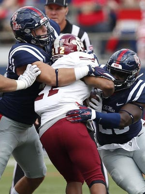 Ole Miss defensive end John Youngblood, left, is ready to take on more reps depending on Fadol Brown's availability.