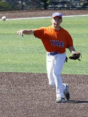 Thomas A. Edison shortstop Logan Peters throws to first