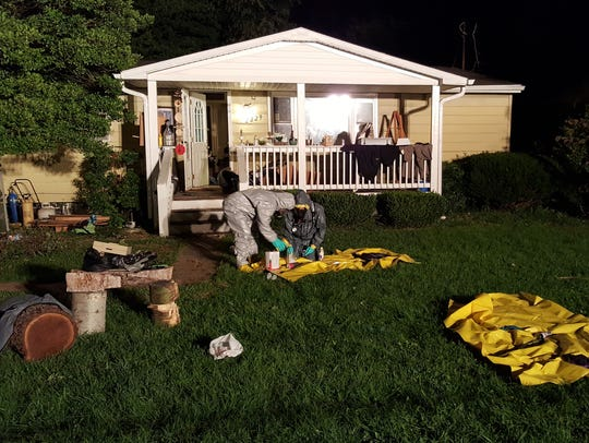 Officers investigate a suspected meth lab Monday night