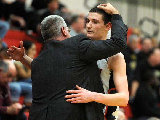 York Suburban senior Ted Hinnenkamp is hugged by head