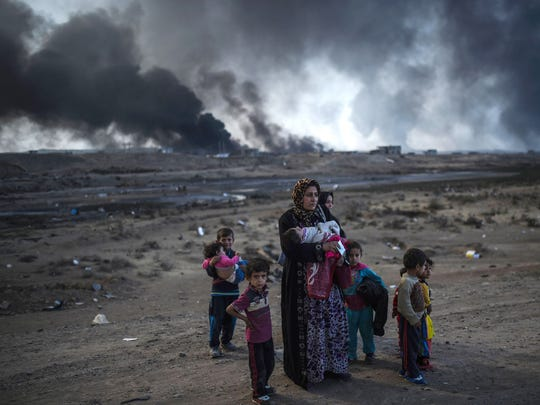 Iraqi families who were displaced by the ongoing operation