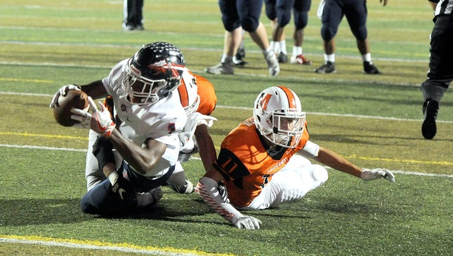 South Doyle's Ton'Quez Ball takes a 12-yard pass from Caleb Wender into the end zone against Morristown East on Thursday night at Burke-Toney Stadium in Morristown.
