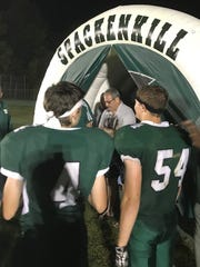 Dave Gettleman walks through an archway during pregame introductions for the Spackenkill High School football team in October.