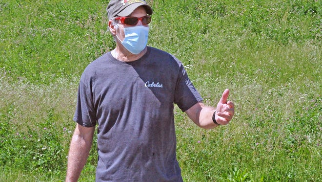 Frank Kuntz, a retired Wooster City Firefighter, wears his mask on his walk at Oak Hill Park as a common courtesy.