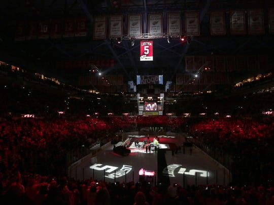 Former Detroit Red Wings defenseman Nick Lidstrom watches as his No. 5 is raised to the rafters of Joe Louis Arena in Detroit, Thursday, March 6, 2014.