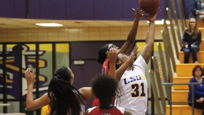 LSUS post Quina Tucker (31) goes up for a rebound against Southwest Thursdday night.