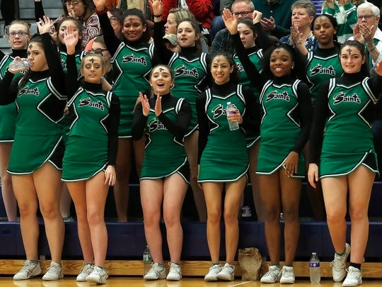 Seton Catholic Central cheerleaders during the Southern Tier Athletic Conference boys basketball championships on Wednesday at Maine-Endwell High School