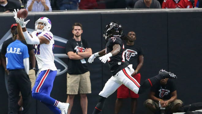 Buffalo Bills wide receiver Jordan Matthews (87) makes a touchdown catch against Atlanta Falcons cornerback Desmond Trufant (21) during the first half of an NFL football game, Sunday, Oct. 1, 2017, in Atlanta.