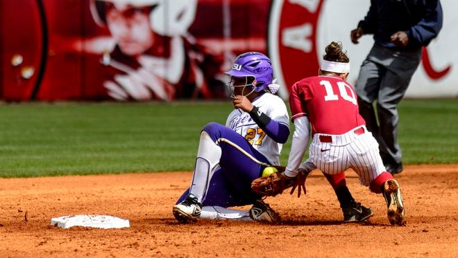 Alabama's Kaila Hunt (10) tags out LSU's Bianka Bell (27) during an NCAA college softball game Saturday, March 29, 2014, at Rhoads Stadium in Tuscaloosa, Ala.