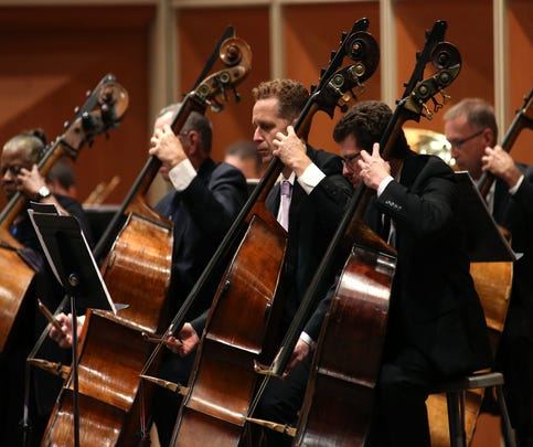 "The Milwaukee Symphony bass section plays Leonard Bernstein's Overture to ""Candide"" during Friday's season-opening performance at the Marcus Center."