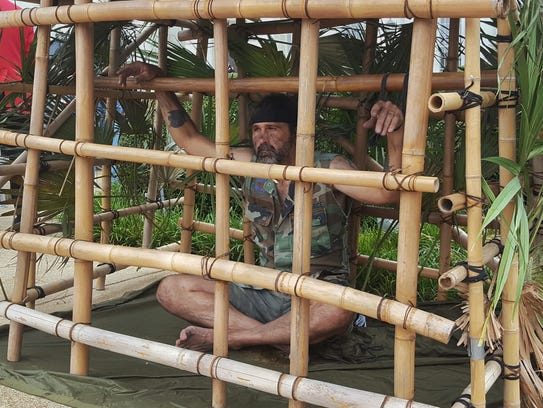 "Raymond ""Little Brother"" Dionne sat in a bamboo cage"