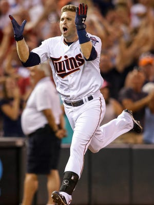 Minnesota Twins second baseman Brian Dozier (2) celebrates his three run home run to win the game against the Detroit Tigers in the ninth inning at Target Field. The Twins win 8-6. Mandatory Credit: Bruce Kluckhohn-USA TODAY Sports ORG XMIT: USATSI-215958 ORIG FILE ID:  20150710_gav_sk1_273.jpg