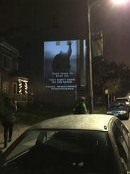 Marchers cheered when they saw a projection on a building