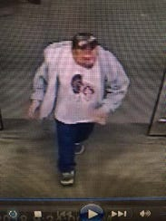 Another view of a suspect wanted for shoplifting from