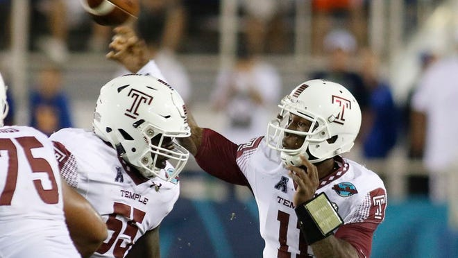Temple quarterback P.J. Walker (11) throws during the first quarter against Toledo in the Boca Raton Bowl NCAA college football game Tuesday, Dec. 22, 2015, in Boca Raton, Fla.