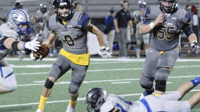 A Georgetown defender reaches for the ball as Stephenville's Gavin Rountree (8) tries to gain yardage as teammate Jacob Poston (55)  moves into position to block during the Yellow Jackets' 48-8 win over the Eagles last season at Memorial Stadium. Rountree is switching positions this year to be the staring quarterback for the Yellow Jackets.