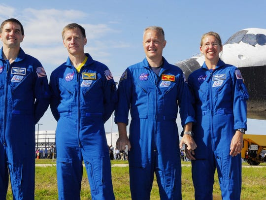 STS-135 crew Astronuats left to right, Rex Walheim,