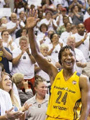 Tamika Catchings acknowledges the crowd following action