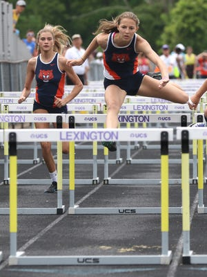 Galion's Kerrigan Myers (right) and Smanatha Comer compete in the 100 hurdles at the D-II regional meet at Lexington High School on Saturday.