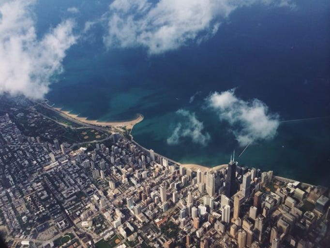 A sun-kissed aerial view of the Chicago skyline and
