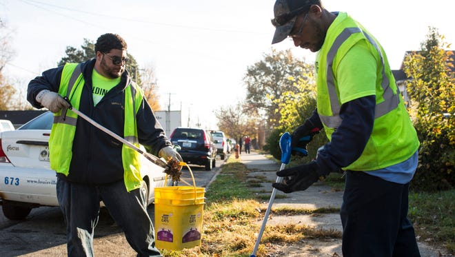 """Jon Board, left, and Chris Hamilton pick up trash along Greenwood Avenue during the city's """"Building Our Blocks"""" neighborhood clean-up event in the Parkland area on Thursday morning. Workers covered eight blocks bounded by Kentucky Street, Virginia Avenue, 26th and 32nd streets. Nov. 17, 2016"""