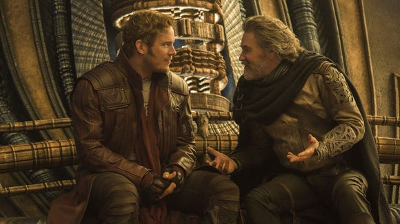"Peter Quill (Chris Pratt) hangs with his dad (Kurt Russell), a living planet, in ""Guardians of the Galaxy Vol. 2."""