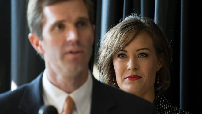 Kentucky educator Jacqueline Coleman looks on as running mate Kentucky attorney general, Andy Beshear, announces his governor candidacy Monday in Louisville, Kentucky. July 9, 2018