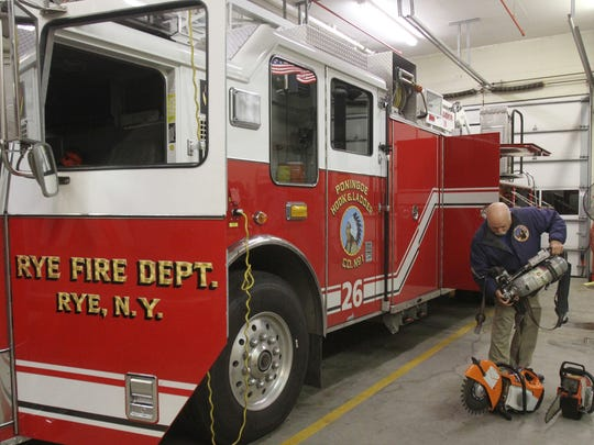 Rye Fire/Police Captain Lester Millman looks over some