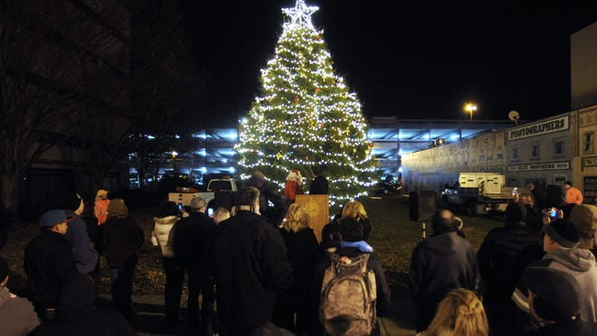 People gather for the lighting of the Christmas tree during the 2012 Celebration of Lights in the City of Poughkeepsie.