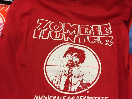 """A """"Zombie Hunter"""" T-shirt shows you mean business."""