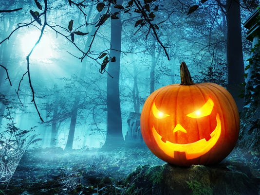 Jack o lantern in blue moonlight