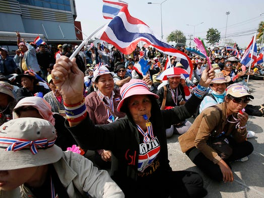 Anti-government protesters rally outside the defense building Jan. 22 in Bangkok, Thailand. Gunmen shot and wounded a leader of a pro-government movement as demonstrators seeking to overthrow Prime Minister Yingluck Shinawatra defied a state of emergency law.