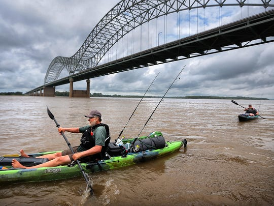 Army veterans Logan Hastings (right) and his dad Jeff Hastings paddle into Memphis Monday afternoon during a  2,358-mile river trek down the Mississippi River to bring awareness to veteran suicide and raise funds to support the efforts to help others avoid a that tragic end.