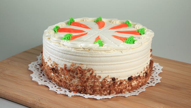 """ACME bakeries are busy baking traditional treats like specialty cookies and cakes during the holiday season. Sure to top the """"wish list"""" of many dessert lovers is carrot cake with cream cheese icing."""