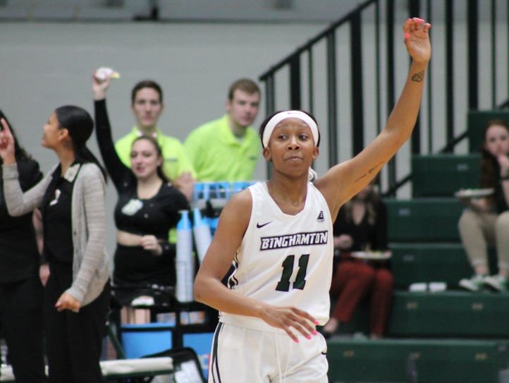 Senior Imani Watkins waves after hitting a three-pointer