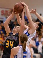St. Cloud Cathedral's Hallie Hupf (34) tries to get