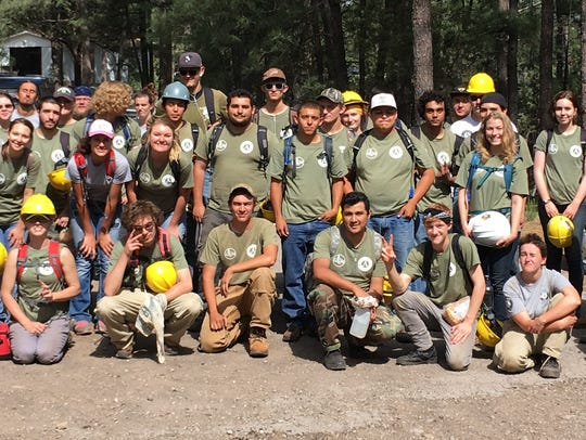 A group of 50 young people builds hiking and biking