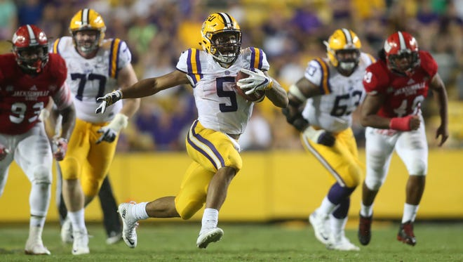 Sep 10, 2016; Baton Rouge, LA, USA;  LSU Tigers running back Derrius Guice (5) carries the ball against the Jacksonville State Gamecocks during the second half at Tiger Stadium. LSU defeated Jacksonville State 34-13. Mandatory Credit: Crystal LoGiudice-USA TODAY Sports