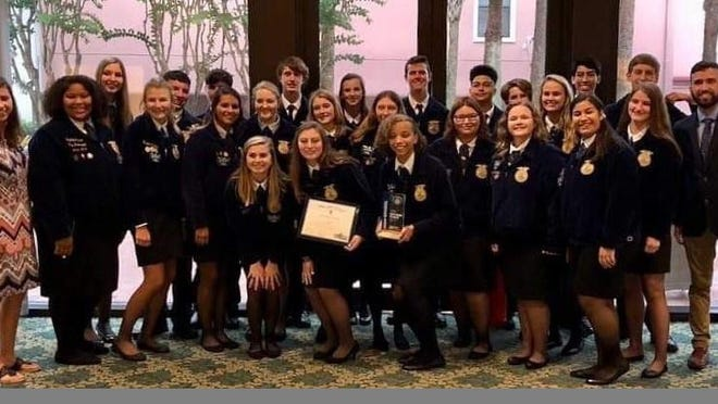 The Santa Fe High School Future Farmers of America chapter has been  named top Florida chapter. Also pictured are Academic of Agriscience Director Brooke Bailey and Academy of Veterinary Assisting Director Brian Skipper.