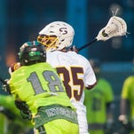 Salisbury attackmen Mike Kane (20) and Carson Kalama (33) celebrate a goal against Stevenson on Wednesday night at Sea Gull Stadium. Go to DelmarvaNow.com for a full recap.
