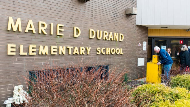 The Daily Journal's Les Olson and Deb Marko deliver a Little Library to Durand Elementary on Wednesday, February 22.