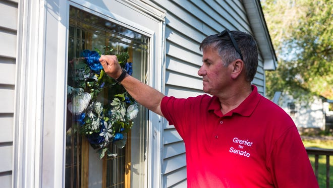 Woodstown resident Francis L. Grenier, the Republican state Senate candidate in the 3rd Legislative District, knocks on doors in a Franklin Township neighborhood on September 29.