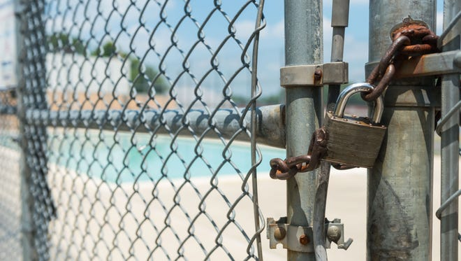 A lock on the Plum St pool that will be closed until at least July 4th.