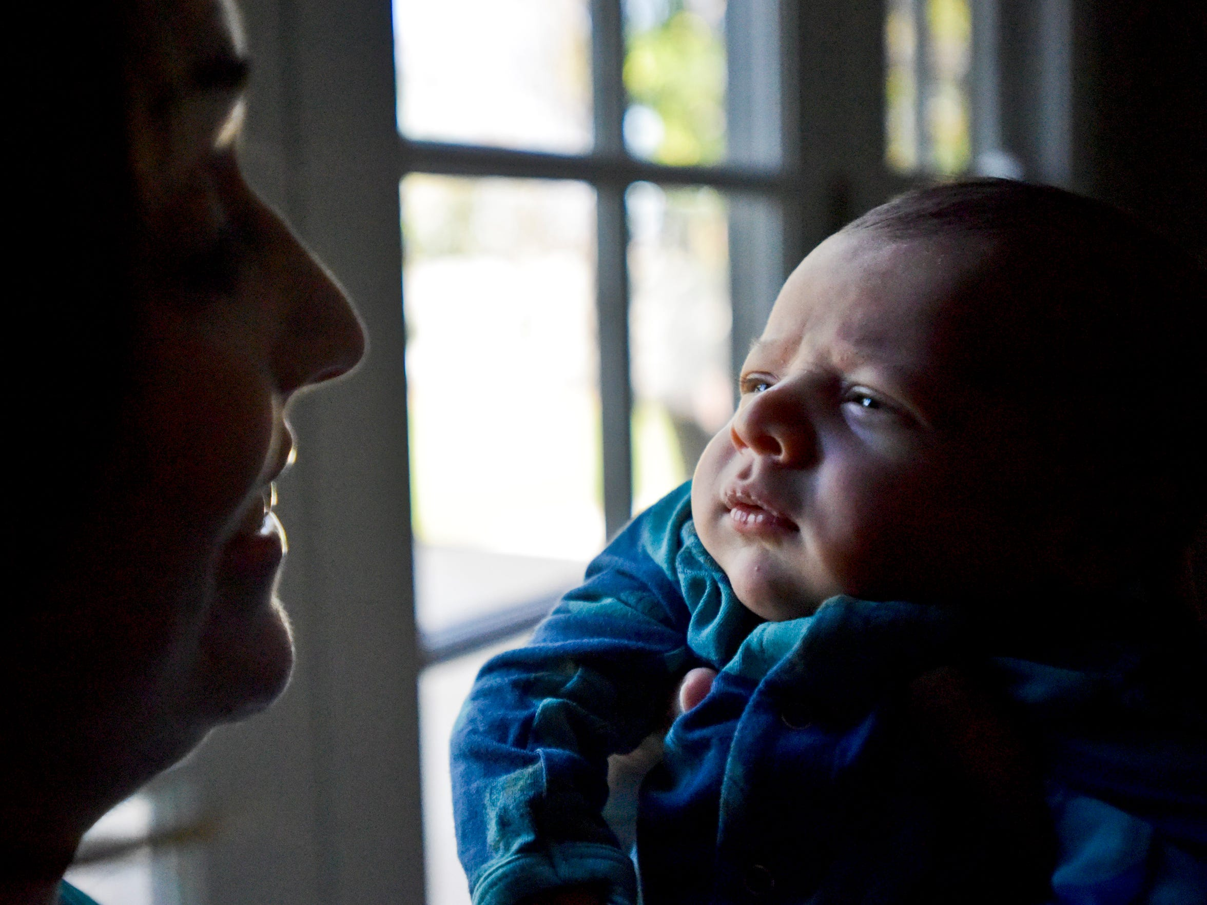 Dr. Tanya Altmann, left, holds her newborn son, Maxton, right, at their home in California. She's afraid to take him outside these days because of the measles outbreak.