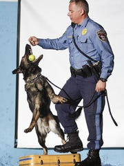 Brick police said goodbye early Monday morning to Dakota, who was euthanized after suffering from cancer. Dakota is shown in this 2008 photo with police officer Jeff Fornarotto, demonstrating how dogs find drugs by biting a tennis ball covered in scent.