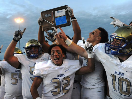 Reed players celebrate after defeating Reno for the