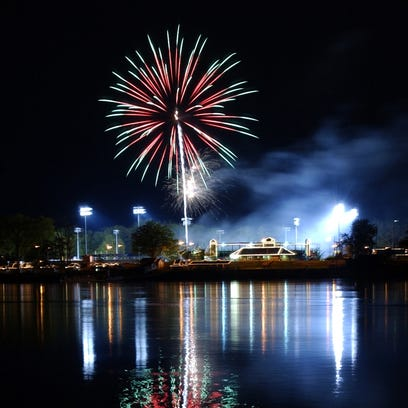 Fireworks reflect off the glassy waters of the Susquehanna