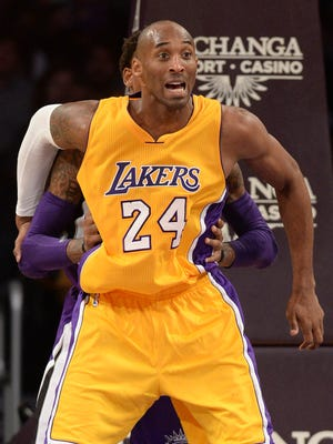 Los Angeles Lakers guard Kobe Bryant (24) looks for a pass in the first half of the game against the Sacramento Kings at Staples Center.